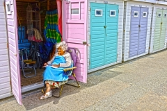 Old Woman front his Beach Hut