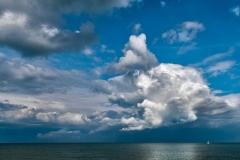 White Sail under White Cloud
